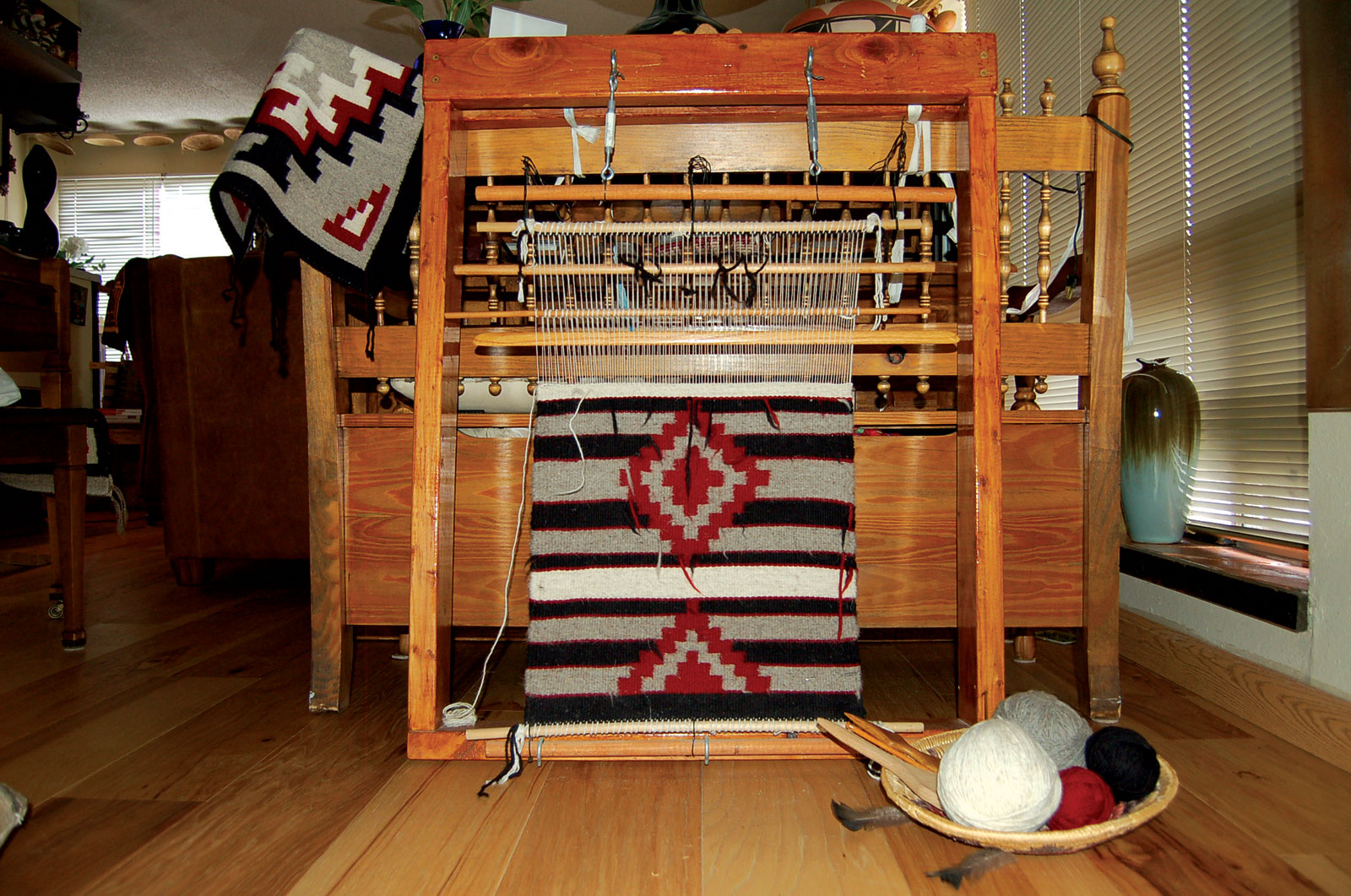 SMALL COTTONWOOD CHIEF'S BLANKET, shown in progress on loom, by Tazbah Gaussoin   of natural dyes, Navajo Churro Sheep wool, 2017.  Photograph by Tazbah Gaussoin.