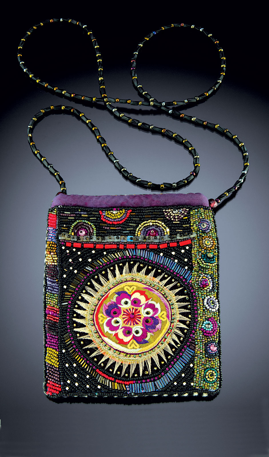 SHANGHAI BAG of glass seed beads embroidered with a needle and fishing line, embellished with coral, labradorite and fire-polished glass; lined in silk, and backed with Italian wool, 13 centimeters x 15 centimeters with 112 centimeters hand-beaded strap, 2016.