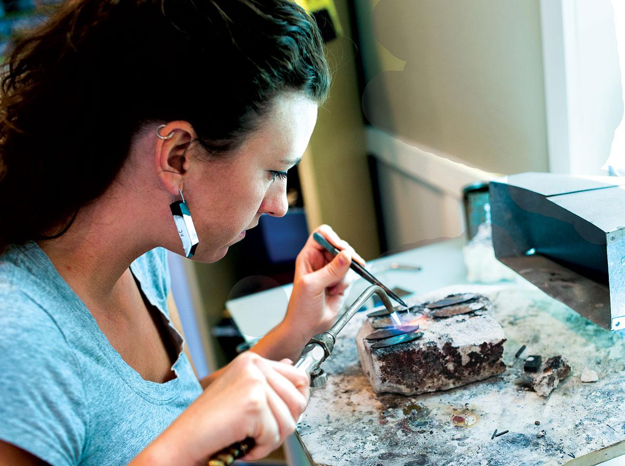 KAT COLE applying enamel.  Photograph by Gail Reid.
