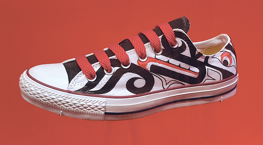 SPIRIT WOLF CHUCKS by Louie Gong (Nooksack/Squamish) of fabric dye and acrylic on Converse sneakers, 2010.  Photograph by Ornament.