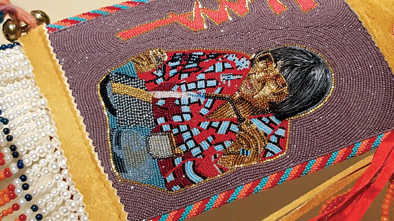 HE WAS ICONIC by Kenneth Williams Jr. (Northern Arapaho/Seneca) of glass beads, turquoise, coral, seed pearls, brass, wool, yarn, brain-tanned hide, gold, and human hair, 2014. Represented is famed Native American jeweler Charles Loloma.  Photograph by Ornament.