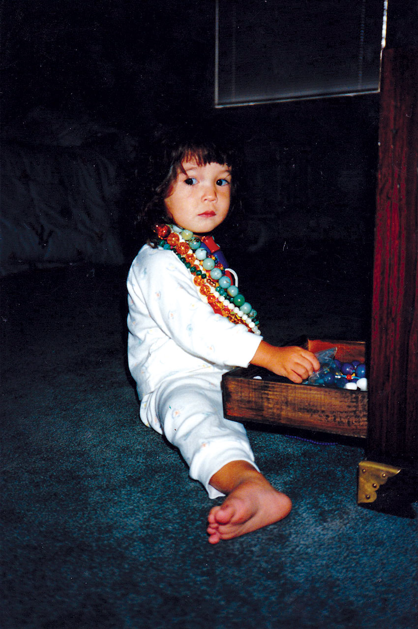 GENEVIEVE YANG breaking into her mother's jewelry box, Palo Alto, California, 1988.
