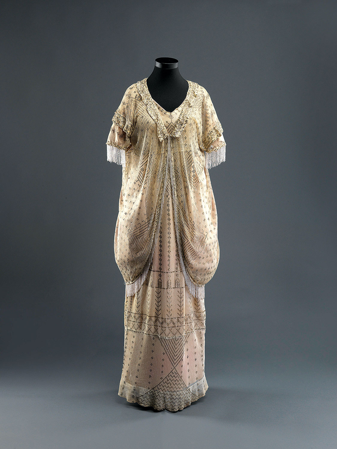 WOMAN'S ENSEMBLE of tulle and silver-tinsel embroidery, probably Alexandria, Egypt, 1920s.  Photograph by Elie Posner, courtesy of The Israel Museum, Jerusalem.