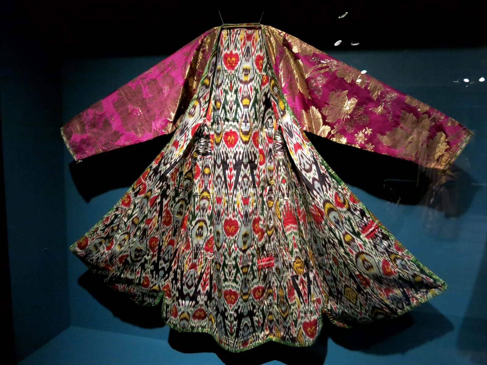 WOMAN'S COAT ( KALTACHAK ) of brocaded silk, ikat-dyed silk and cotton lining, Bukhara, Uzbekistan, late nineteenth century.  Photograph by Patrick R. Benesh-Liu/Ornament.