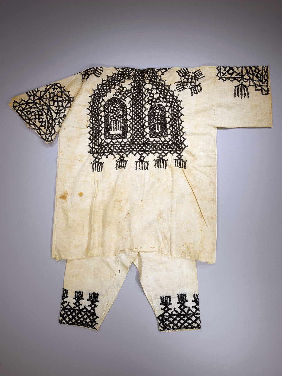 BOY'S SUIT FOR A SYMBOLIC CHILDREN'S WEDDING of cotton and cotton-thread embroidery, Tafilalt, Morocco, mid-twentieth century.  Photograph by Mauro Magliani, courtesy of The Israel Museum, Jerusalem.