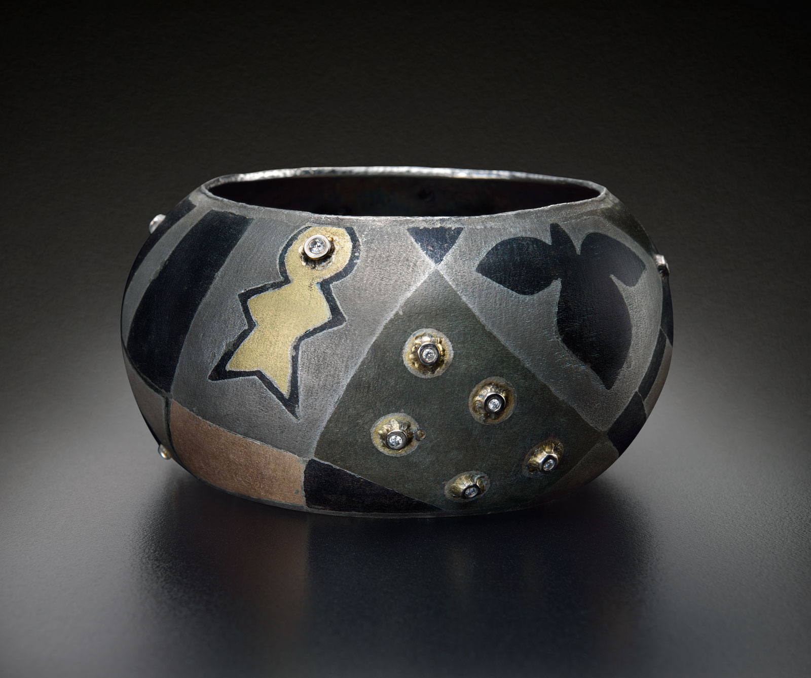 HUMAN GRID BRACELET of sterling silver, eighteen karat gold,  shibuichi ,  shakudo , diamonds, 2013.