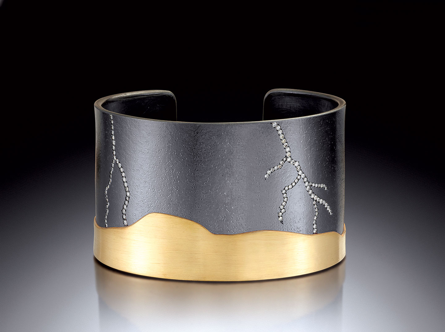 LIGHTNING CUFF WITH TWO BOLTS of oxidized sterling silver, eighteen karat yellow gold, white diamonds, 6.4 x 3.8 x 4.4 centimeters, 2016.
