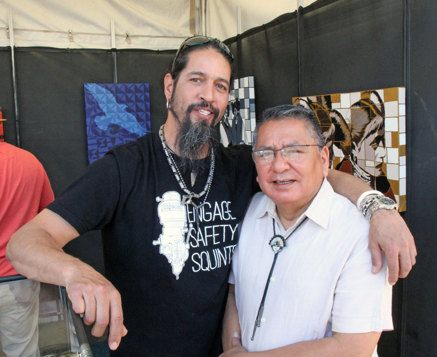 PAT PRUITT AND RAYMOND YAZZIE, two outstanding Native jewelers who approach the medium from different angles. Pruitt uses modern materials and technology to create precise works that are informed by traditional symbolism, while Yazzie makes lush jewelry which incorporates his own personal touch to traditional style. Raymond Yazzie was an award judge for this year's Best of Show.  Pruitt was featured in Ornament Volume 37.1, while Yazzie and his brother Lee were covered in an exhibition review of their work, Glittering World, done in Ornament Volume 38.4.   www.ornamentmagazine.org/shop/ornament-print-edition-volume-371   www.ornamentmagazine.org/shop/ornament-print-edition-volume-384