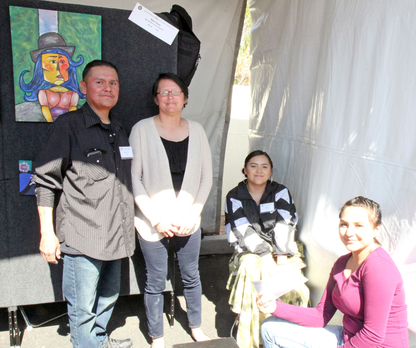 MONTY CLAW, KAREEN CLAW, and his daughters at their booth. Monty Claw is a jeweler, a painter, a fan maker, and above all an artist. This year he brought his jewelry, while his daughter Elle took over the two-dimensional art with her own paintings.