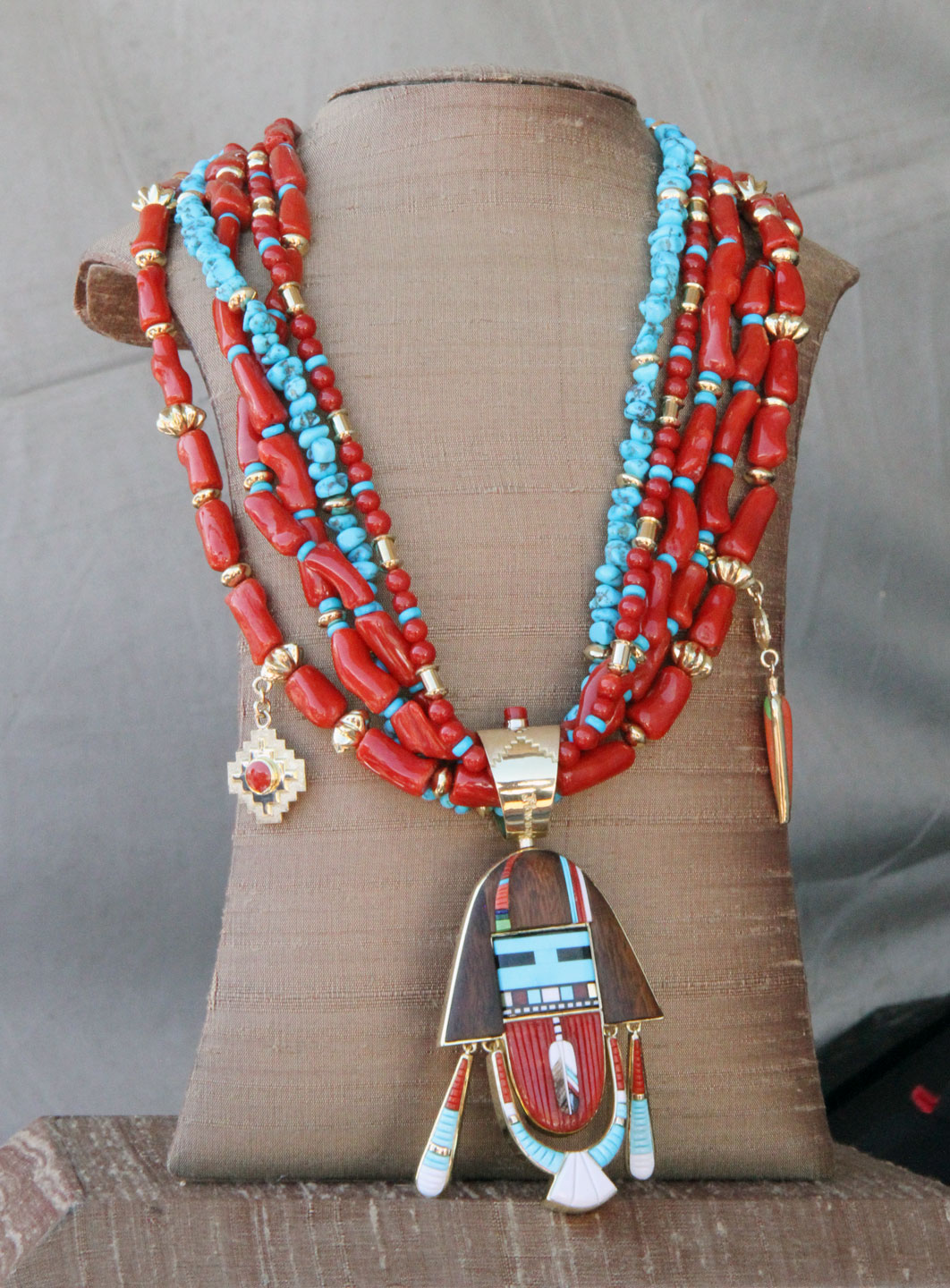 PENDANT by Jesse Monongya, strung on a coral and turquoise bead necklace. Monongya finished this pendant in 2018.