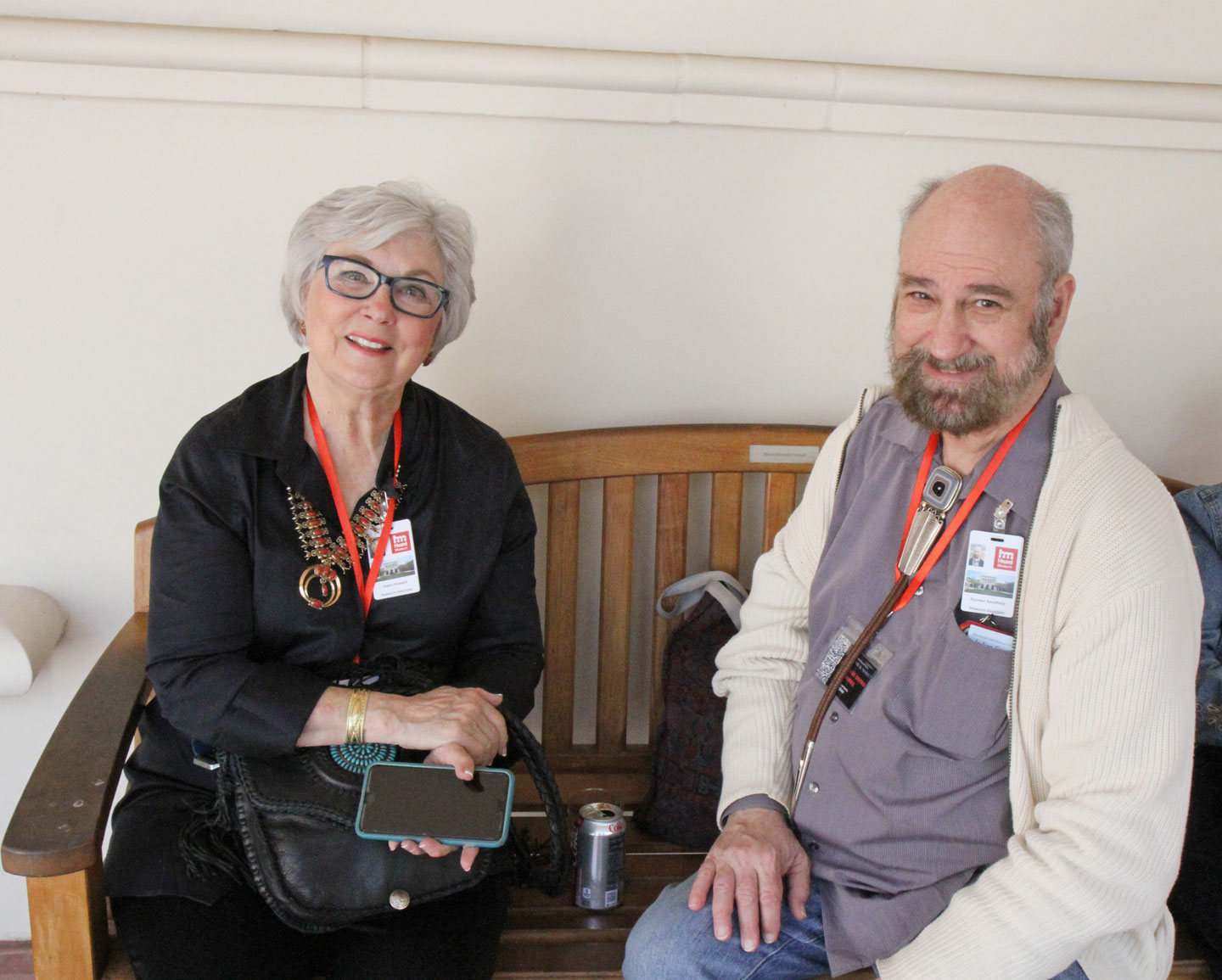 "KATHLEEN HOWARD AND NORMAN SANDFIELD, relaxing after their book signing at the Heard Indian Fair. Both have worked with Heard Museum Curator Diana Pardue, in Howard's case cowriting ""Over the Edge: Fred Harvey at the Grand Canyon and in the Great Southwest"". Sandfield and Pardue cowrote ""Awa Tsireh: Pueblo Painter and Metalsmith"", which is also a current exhibition at the Heard Museum. Sandfield is also an expert on Japanese netsuke carvings, which just goes to show one can never wear too many hats."