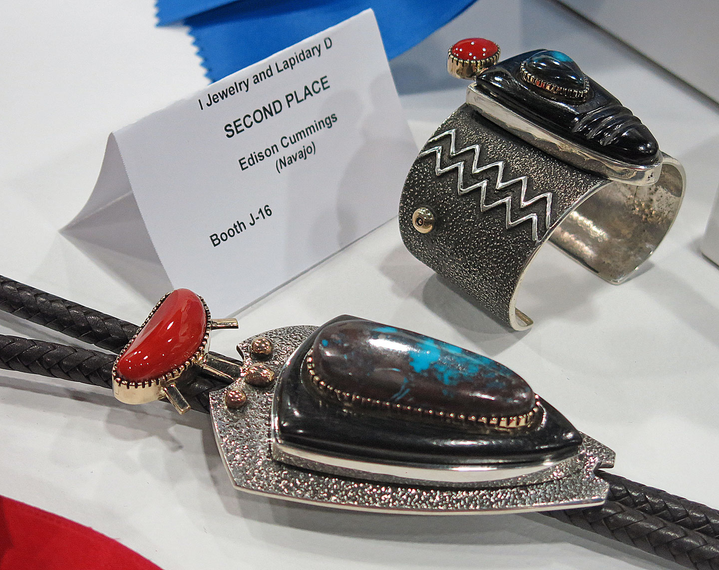 BOLO TIE AND BRACELET by Edison Cummings (Diné), who won Second Place in Jewelry and Lapidary D.