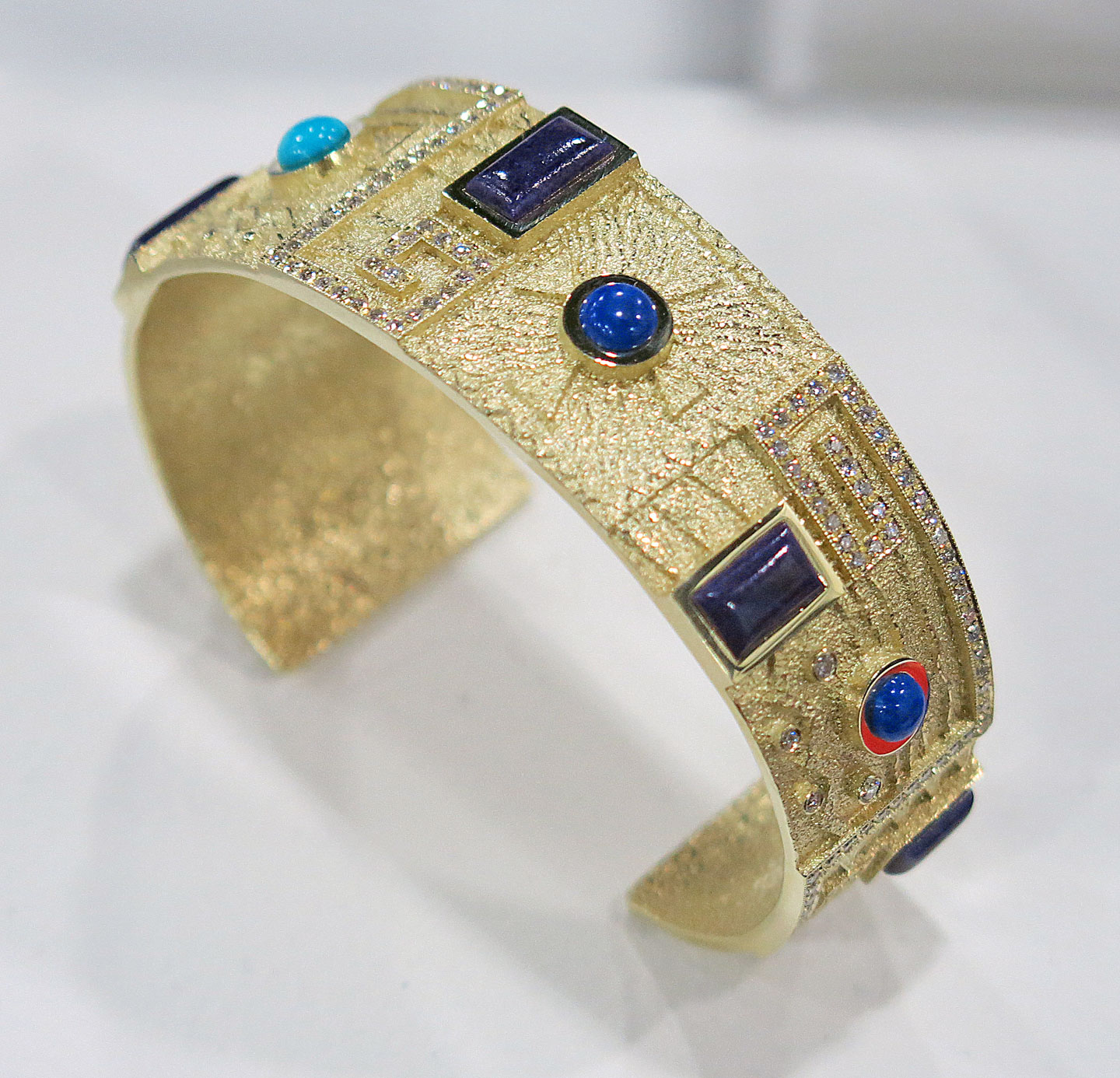 BRACELET by Ric Charlie (Diné), who won First Place in the Jewelry and Lapidary C category for his suite of bracelet, earrings and necklace. Diamonds are set into the rectangular spirals.