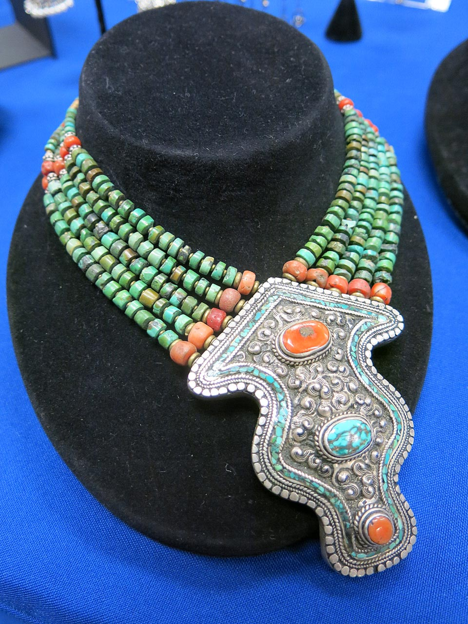 Antique silver pendant, which shows Tibetan influences.
