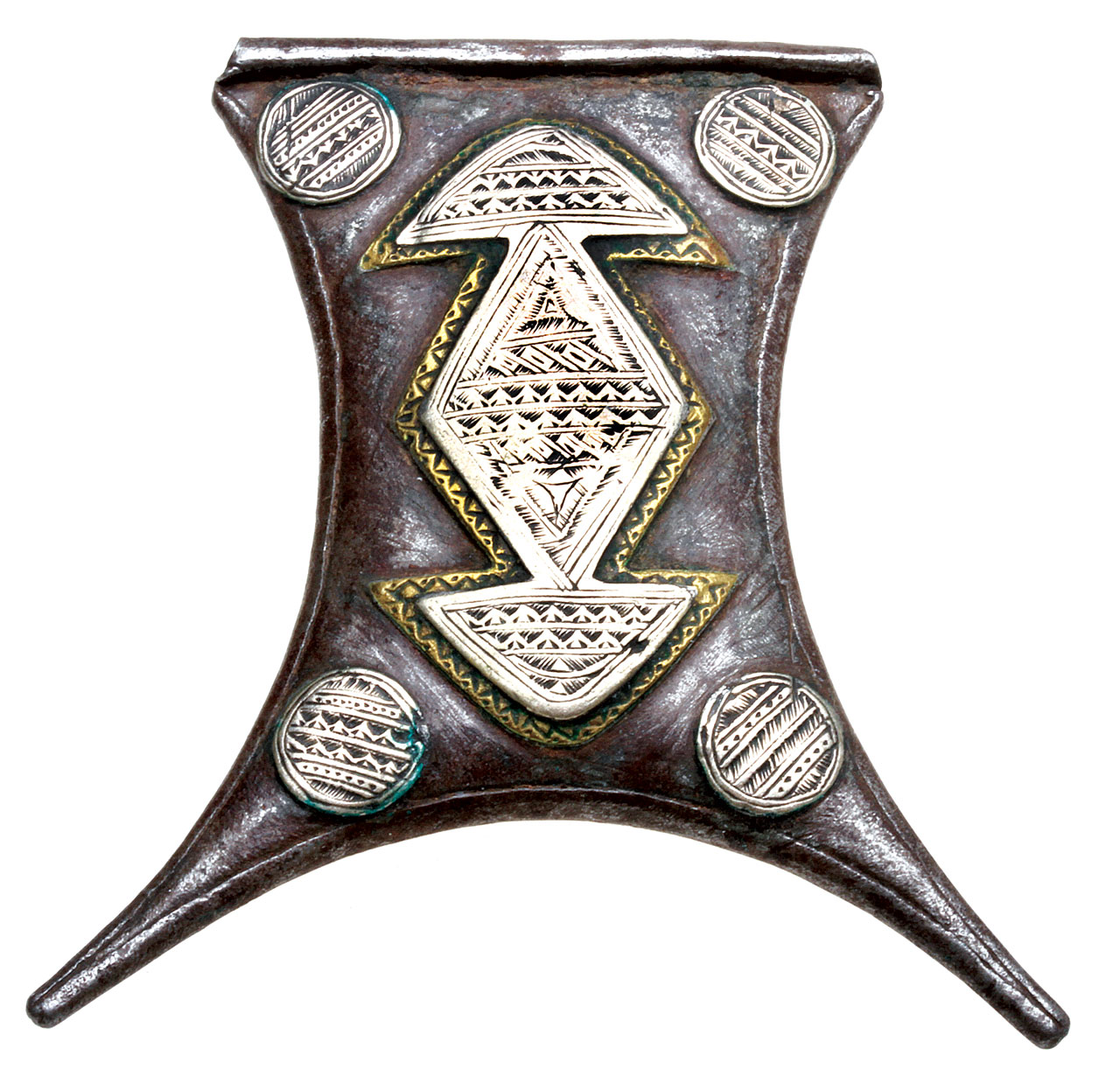 ELEGANT BUT WORN TUAREG GERBA-SHAPED TCHEROT AMULET, of white metal and brass sweated onto steel and cold-joined by bezels. The back has no decorations. This shape is a stylized goatskin, used to carry water. The amulet is 6.5 centimeters tall and subtly domed.