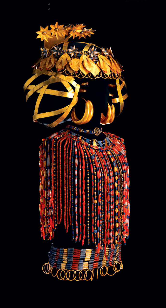 QUEEN PUABI REGALIA of headdress, beaded cape and jewelry of gold, lapis lazuli and carnelian, discovered on the queen's body in her tomb at the Royal Cemetery of Ur, circa 2450 B.C. Puabi was wearing about five pounds of jewelry, mostly gold, on her head and about seven and a half pounds of jewelry, mostly semiprecious stone beads, on her body.  Photograph by Bruce White .