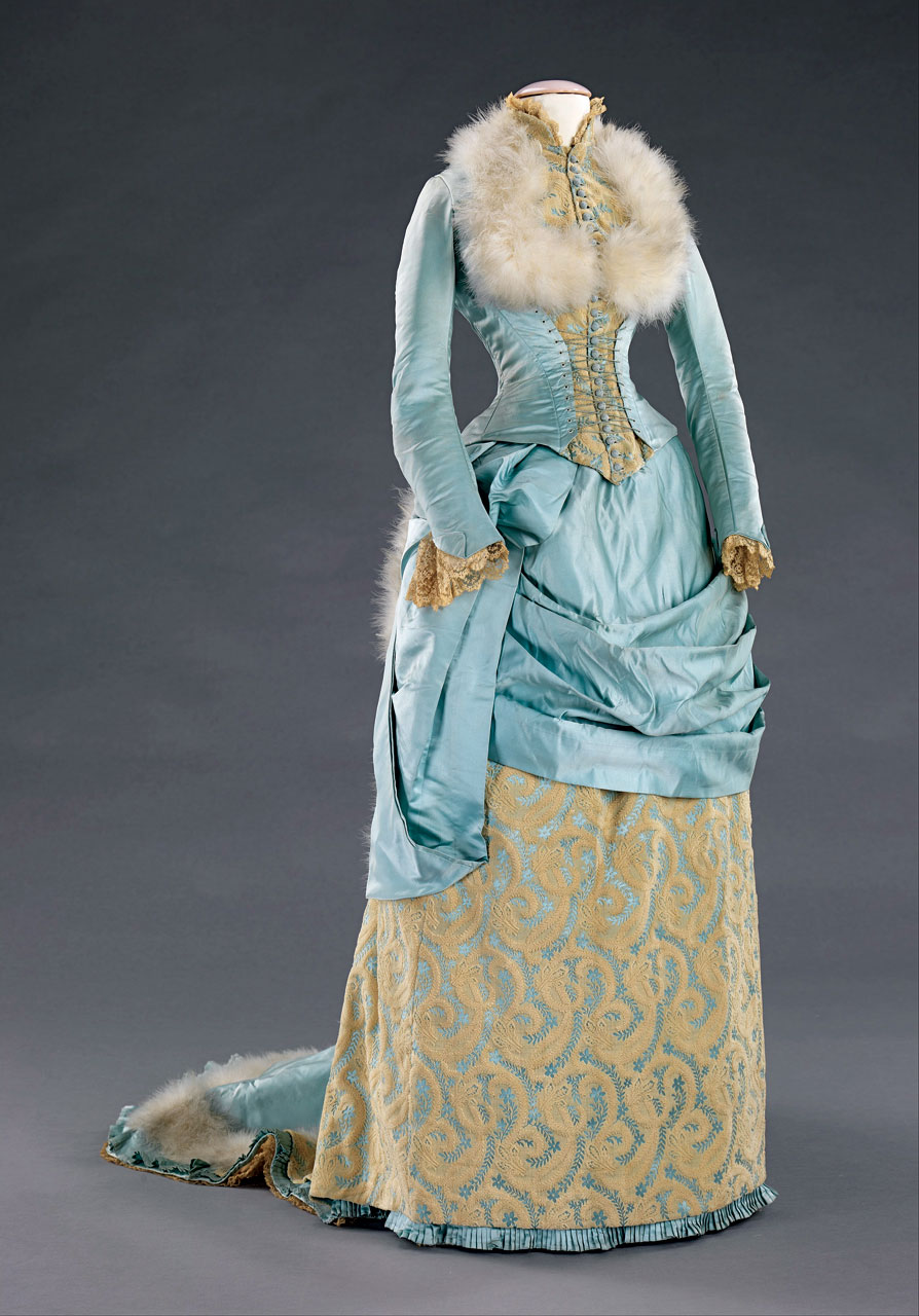 SILK SATIN EVENING DRESS with feathers and swansdown accents by R.H. White & Co (1853-1957), Boston, Massachusetts, 1885.  Metropolitan Museum of Art, Brooklyn Museum Costume Collection at the Metropolitan Museum of Art, 2009.