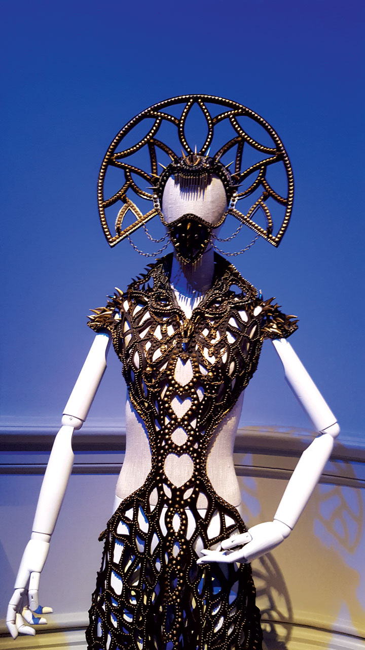 NAGANA BRASS GOWN by Gelareh Alam of hand-cut leather, and custom metal work by Jungle Tribe, 2014. Although resembling something out of Mad Max, Alam's intention for both pieces in the exhibition were born of a desire to express her thoughts on the emotional investment, both good and difficult, that love requires in a wearable piece.  Photograph by Carolyn L.E. Benesh.