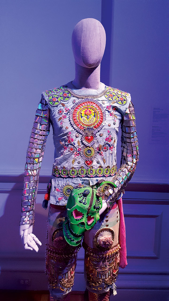READY TO LOVE ENSEMBLE by Manish Arora of thread, silk, beads, crystals, faux patent leather, felt, sequins, and iridescent armor, hand-embroidered, hand-embellished, hand-appliquéd, chain-linked by hand, 2016.  Photograph by Carolyn L.E. Benesh.
