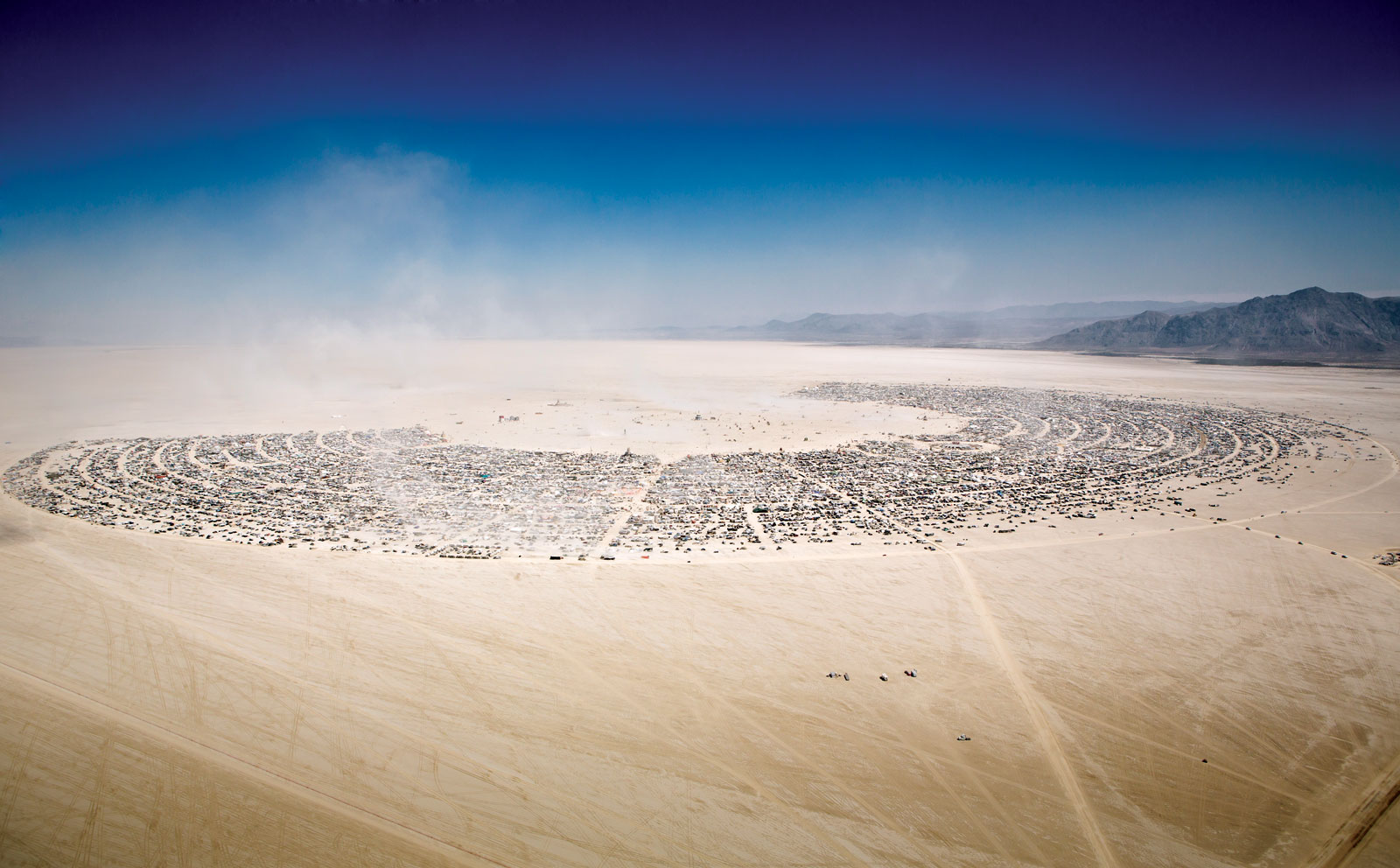 AERIAL VIEW of Burning Man gathering at Black Rock City, 2012.   Photograph by Scott London.