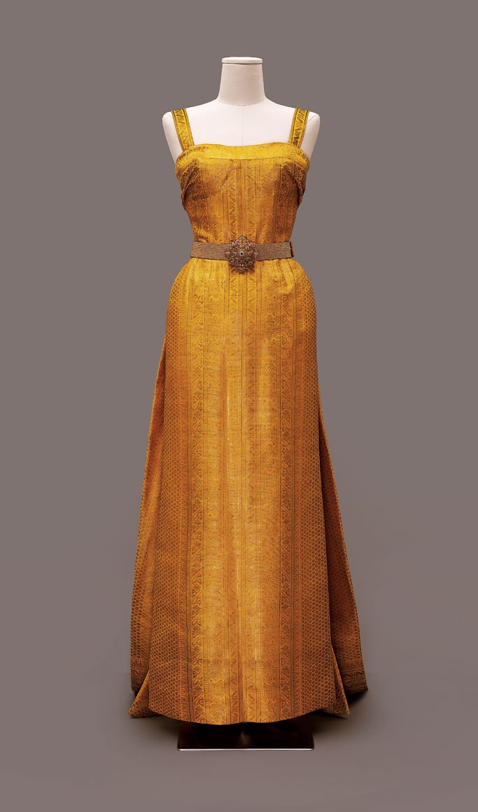 EVENING DRESS of Thai silk and metallic brocade, 1960. This is one of several simple, Western-style evening dresses Balmain made for the 1960 tour.