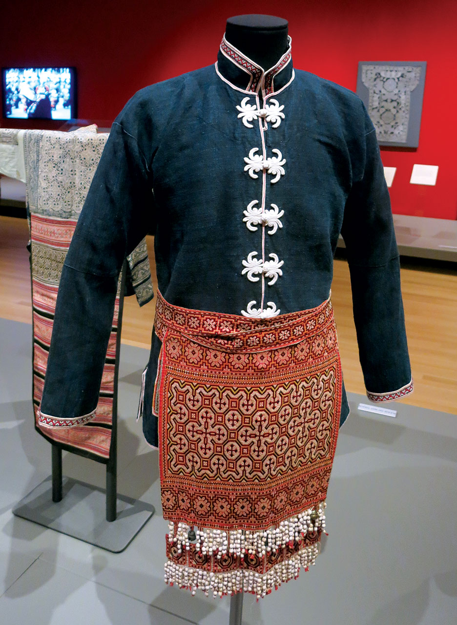 MIAO YOUNG MAN'S JACKET of silk, cotton, metal bells, Job's tears, embroidered, Suoga Township, Liuzhi County, Guizhou Province, China, mid-twentieth century.  Photograph by Patrick R. Benesh-Liu.
