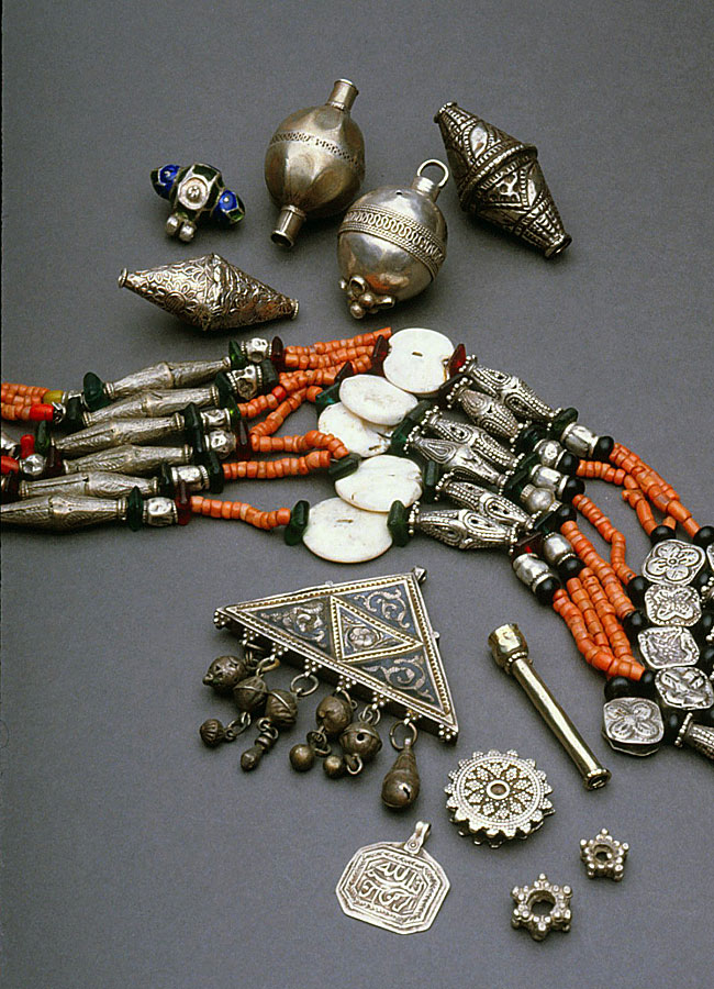 Ethnographic silver beads, components, amulet and necklace from Afghanistan; necklace uses shell and coral beads. RKL