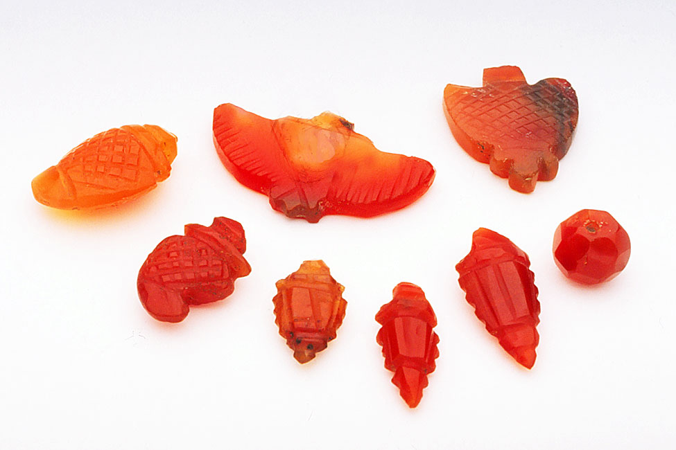 Old or vintage Indian made small carnelian bead and pendants, with much lapidary grinding. RKL