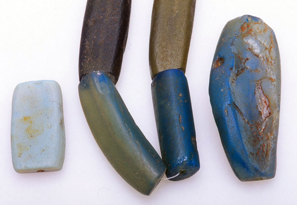 Various dichroic glass segi/koli/cori beads from Africa, under reflected light. RKL