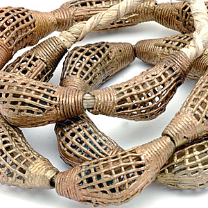 Brass or bronze lost-wax cast beads made from reclycled metal in Ghana. CW