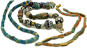 Ancient glass beads, with central strand mostly Islamic glass beads. CW