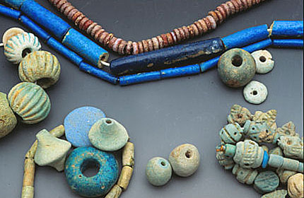 Ancient faience beads from cultures around the world; top strands are from ancient Egypt. See Ornament 23/3, 2000 and 32/4, 2009. RKL