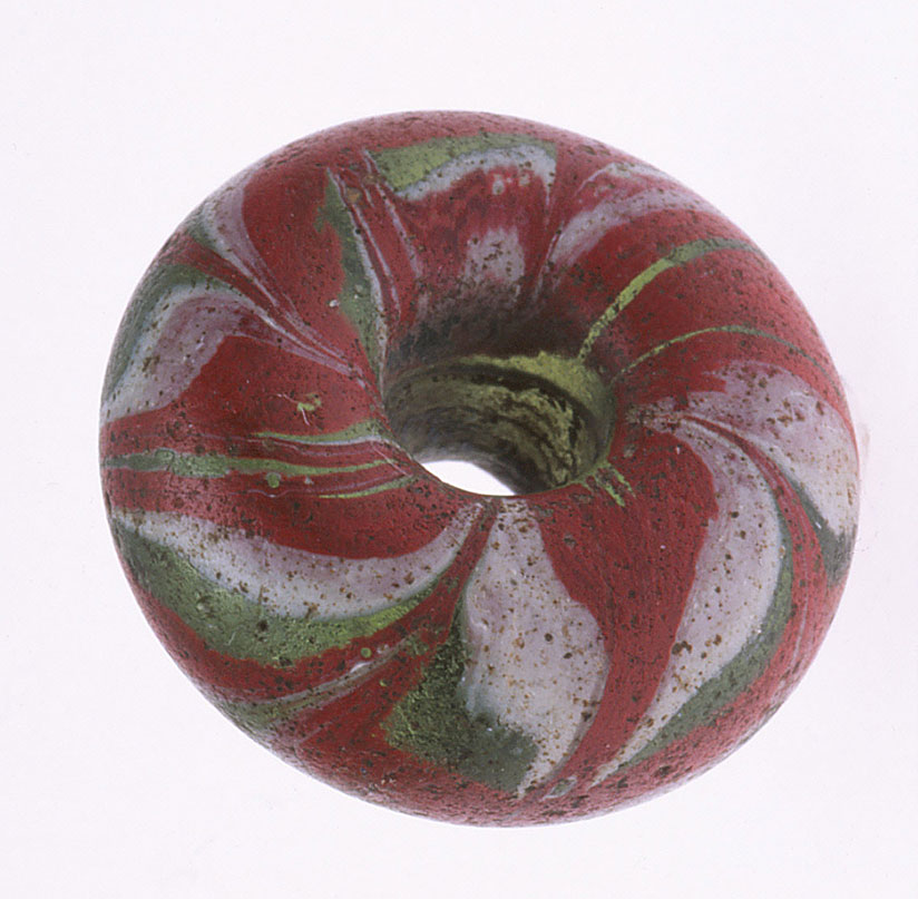 Glass ring bead or Ringperlen, possibly late La Tene, last two centuries BCE, from Europe, about 2 cm diameter. RKL