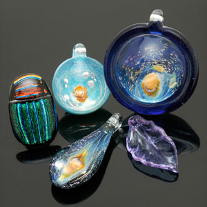 Contemporary art glass beads by Keith Kreitter (3 pendants), Bruce St. John Maher (scarab) and Donna Nova (leaf). CW