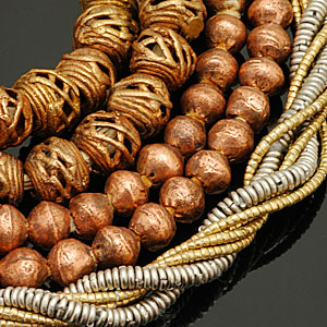 Brass, copper, and white metal beads from Africa. CW