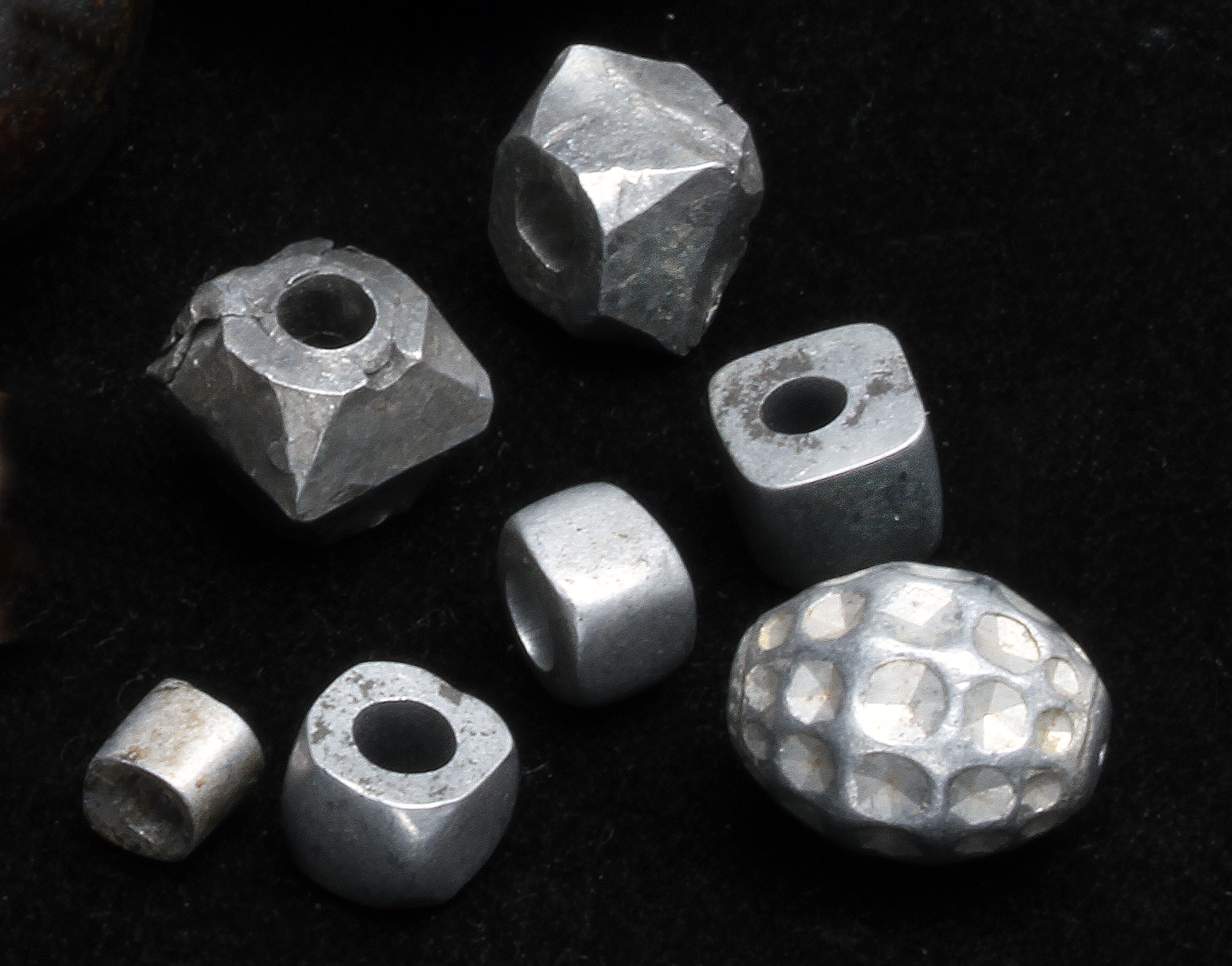 Cast and/or forged aluminum beads from East Africa. RKL