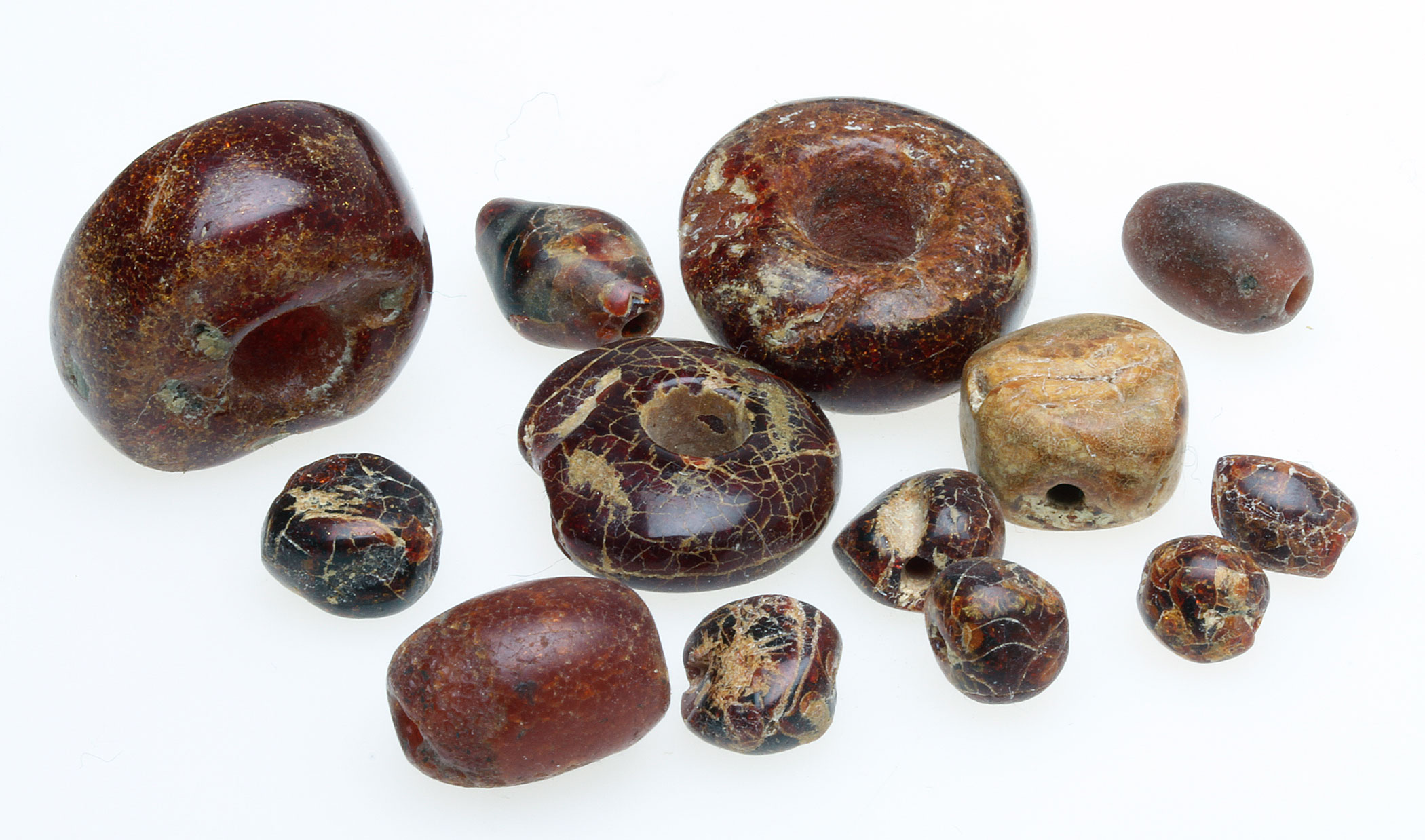 Ancient amber beads, note the extensive crazing. These have been treated with liquid nylon to strengthen them. RKL