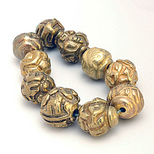 Chinese brass buttons that have been converted into beads. CW
