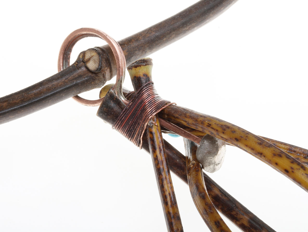 DETAIL OF COPPER LOOP AND WIRE WITH LARGE KNOB, which is trapped by the bundled bamboo culms when it is wire-wrapped with thin, annealed 26 guage copper wire, used on all these bamboo jewelry.