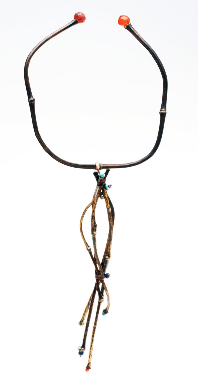 FINISHED TORQUE WITH VERTICAL JIGGED PENDANT OF FIVE CULMS; the torque is also terminated with vintage, facetted Czech glass beads from the African trade, with beads of semiprecious stone or copper balls decorating ends of bamboo culms.