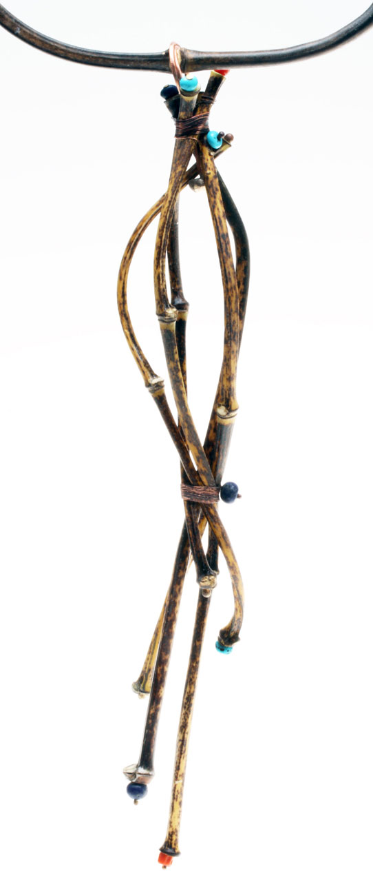 CLOSEUP OF FINISHED VERTICAL JIGGED PENDANT, showing how all the ends of the bamboo culms have been decorated to add interest and draw attention to them. In addition to wirewrapping, some of these bundled culms are held together by pins inserted into drilled holes, to add strength.