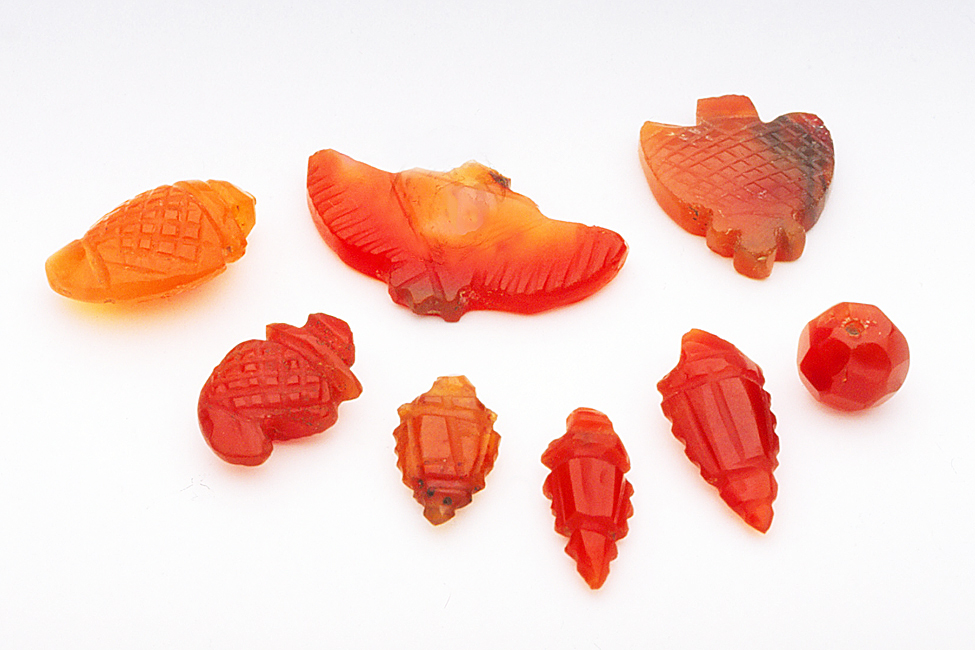 Vintage Indian carnelian beads carved in traditional shapes. RKL