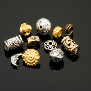 An assortment of American made cast and plated base metal beads. CW