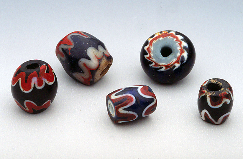 Lampworked imitation chevron beads, possibly Chinese-made, from Kalimantan, Borneo (0.65 to 1.0 cm diameters). RKL
