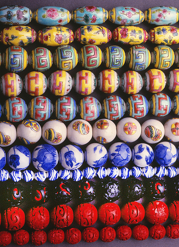 Contemporary Chinese porcelain and, on the last three rows, cinnabar beads. All are beads from the 1980s. RKL