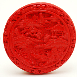 Detailed close up of contemporary large Chinese cinnabar bead. CW