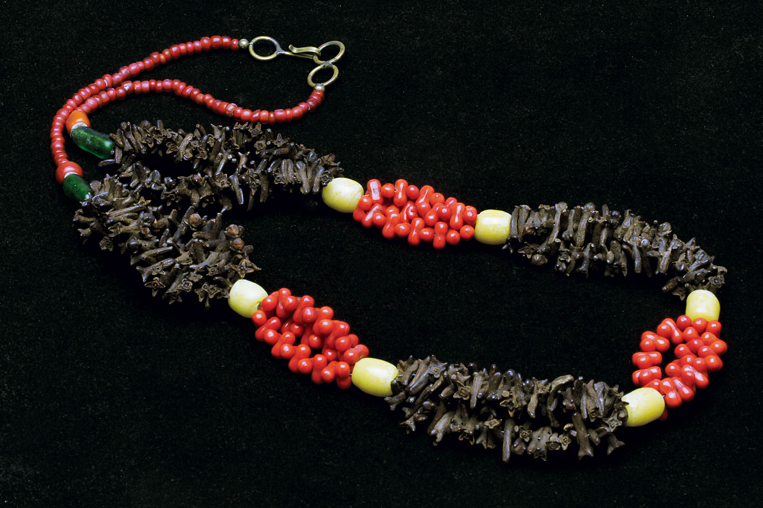 Vintage necklace from Morocco of imitation glass coral, vintage Chinese glass beads and cloves, partially restrung.  Courtesy of M.K. Liu.  RKL