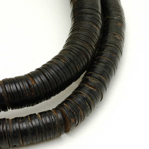 Coconut shell disc or heishi beads from West Africa. CW