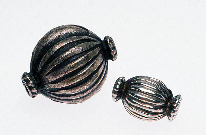 Two Indian or Nepalese collared silver beads. RKL