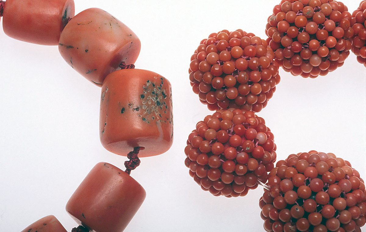 Large and very small (about 2mm) natural coral beads, the latter Chinese. Note how the tiny beads are strung together to form a larger bead. RKL